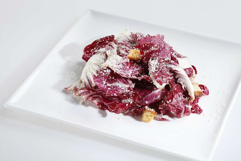 The Radicchio salad from Bar Terra is a combination of straightforward ingredients transformed by the extra step of soaking the lettuce in cold water. Photo: Craig Lee, Special To The Chronicle