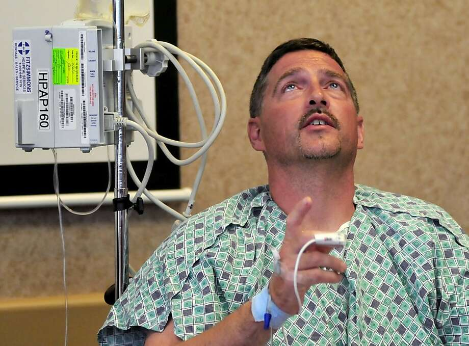 Michael W. Trapp, 42, describes his ordeal during a news conference  at Covenant HealthCare Cooper Campus in Saginaw, Mich. on Thursday, July 28, 2011.   Trapp's plane crashed Tuesday evening near Harbor Beach, about 105 miles north of Detroit. He treadedwater and swam without a life jacket for 18 hours after his small plane crashed into Lake Huron said a number of boats passed him by but couldn't hear his cries for help.   Dean and Diane Petitpren from Grosse Pointe Farms near Detroit saw him waving a sock in the water and hauled him aboard their yacht about on Wednesday. Photo: Jeff Schrier, AP