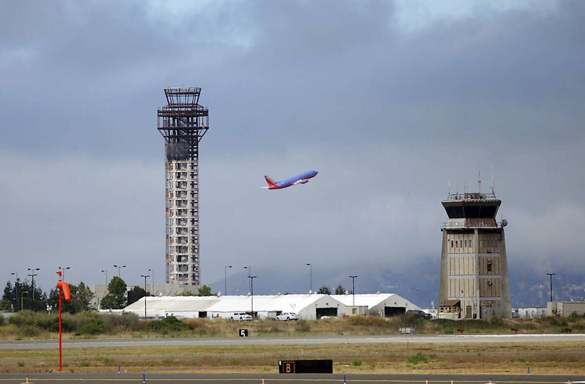 A Southwest Airlines jet takes off near a partially built control tower, left, at Oakland International Airport in Oakland on Tuesday..