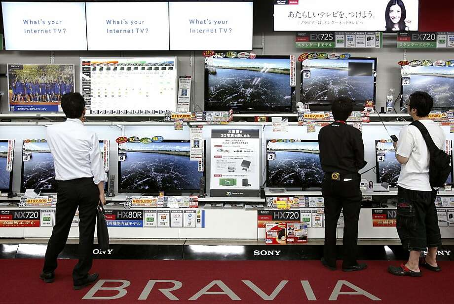 Customers look at Sony Corp. Bravia televisions at an electronics store in Tokyo, Japan, on Thursday, July 28, 2011. Sony Corp., Japan's largest exporter of consumer electronics, cut its annual profit forecast after a slump in demand in the U.S. and Europe led the company to lower its estimate for television sales. Photographer: Kiyoshi Ota/Bloomberg  Ran on: 07-29-2011 Customers look at Sony's Bravia TVs. Sony lowered its target for Bravia TV sales 19 percent and cut its profit estimate 25 percent because of lower TV demand in Europe and the U.S. Photo: Kiyoshi Ota, Bloomberg