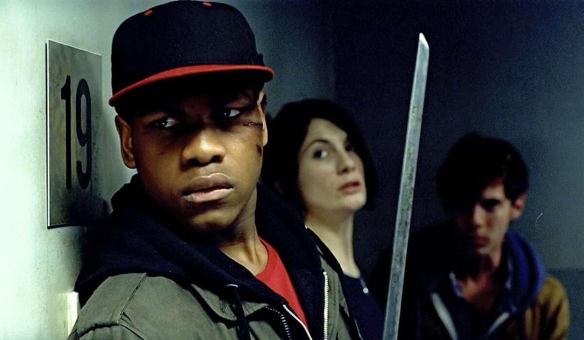 (l to r) John Boyega as Moses, Jodie Whittaker as Sam and Luke Treadaway as Brewis in Screen Gems' ATTACK THE BLOCK.