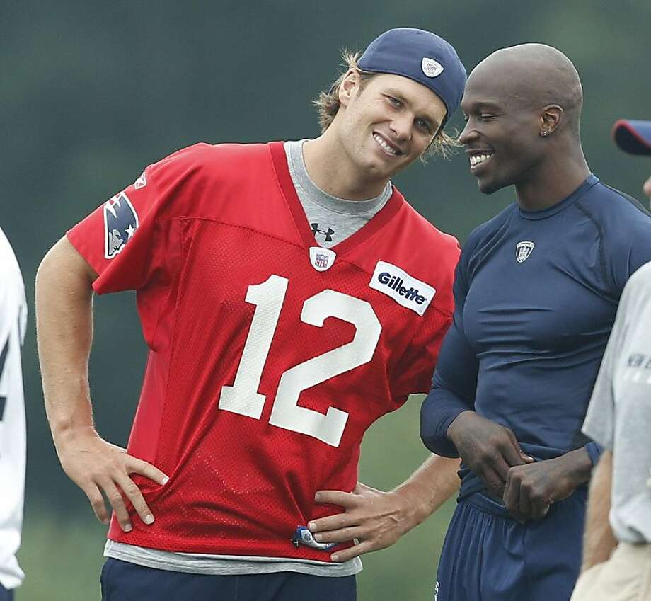 New England Patriots quarterback Tom Brady, left, and wide receiver Chad Ochocinco during an NFL football training camp in Foxborough, Mass., Friday, July 29, 2011. Photo: Charles Krupa, AP