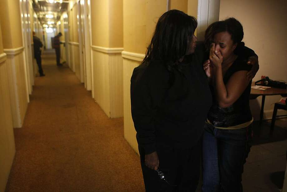 "De De Tillman comforts her tearful daughter Autumn Tillman down the hall from where Santa John Toomey's body was discovered in his room at the Budget Inn in San Francisco Calif.,  on July 29, 2011.  ""This hallway will never be the same without him,"" said De De Tillman. Photo: Audrey Whitmeyer-Weathers, The Chronicle"