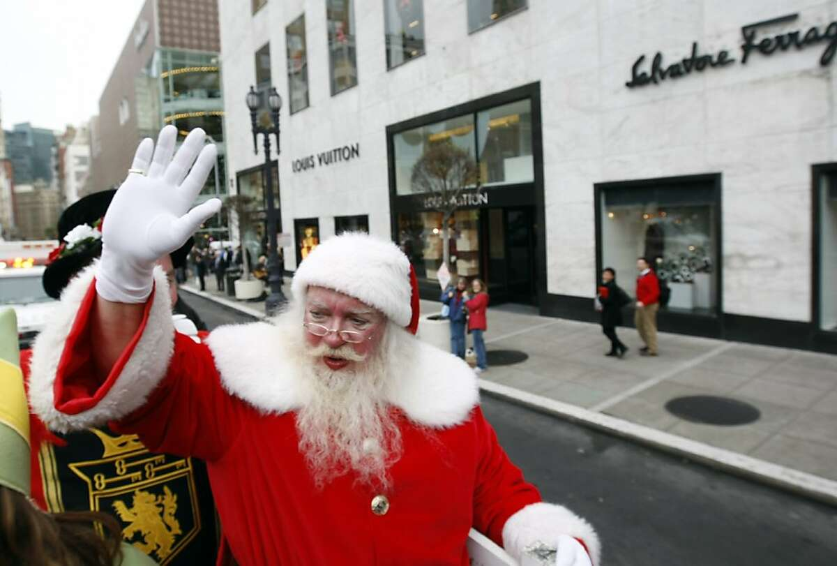"""John """"Santa John"""" Toomey waves to people around union square on his way to his new place of work Lefty O'Doul's on Friday, December 10, 2010, San Francisco, Calif. Toomey, who was fired last weekend as the longtime Macy's Santa Claus, starts his new job as Santa for the annual toy drive at Lefty O'Doul's sport bar and hofbrau."""