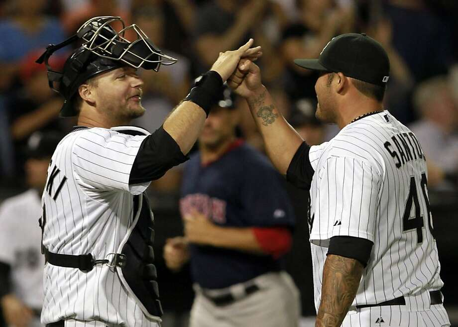 Chicago White Sox catcher A.J. Pierzynski, left, congratulates relief pitcher Sergio Santos after defeating the Boston Red Sox 3-1 during the a baseball game on Friday, July 29, 2011, in Chicago. Photo: John Smierciak, AP