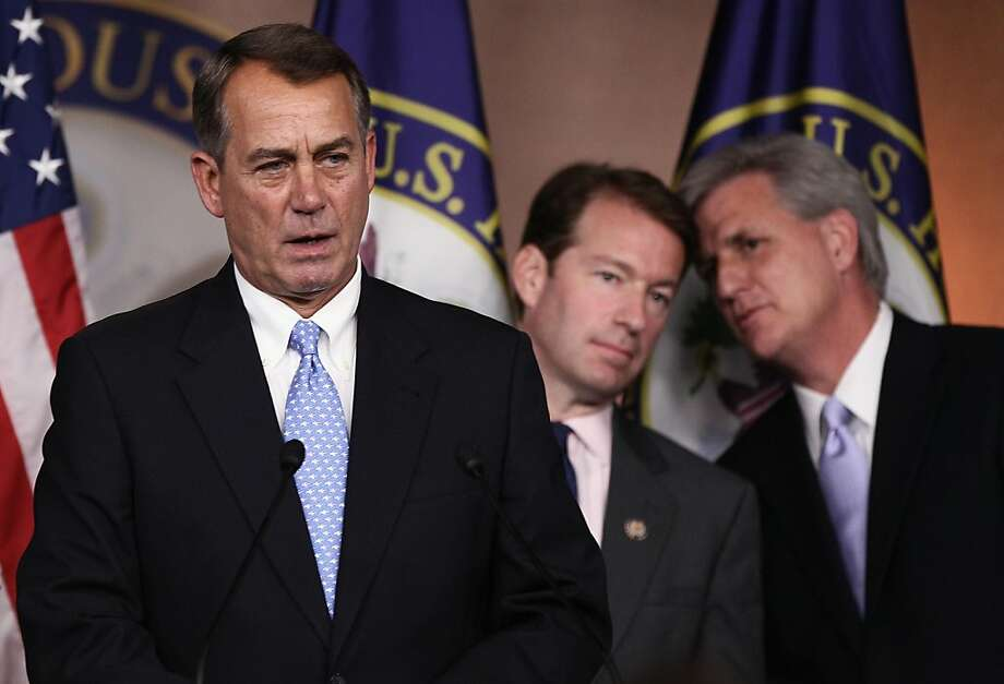 WASHINGTON, DC - JULY 28:  U.S. Speaker of the House John Boehner (R-OH) (L) speaks at a news conference on the debt limit impasse as Rep. Peter Roskam (R-IL) (C) and Majority Whip Kevin McCarthy (R-CA) (R) confer at the U.S. Capitol July 28, 2011 in Washington, DC. Boehner's plan to solve the debt limit impasse is scheduled for a vote in the House of Representatives later this afternoon. Photo: Win McNamee, Getty Images