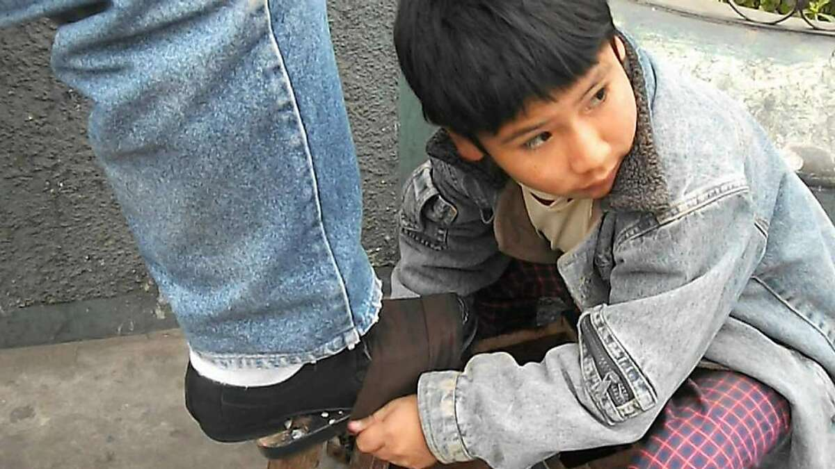 """Cain Abel Tapia Chavez, a shoe-shiner in Peru, in Kevin Macdonald's 2011 documentary """"Life in a Day."""""""
