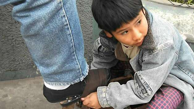 "Cain Abel Tapia Chavez, a shoe-shiner in Peru, in Kevin Macdonald's 2011 documentary ""Life in a Day."" Photo: Scott Free UK"