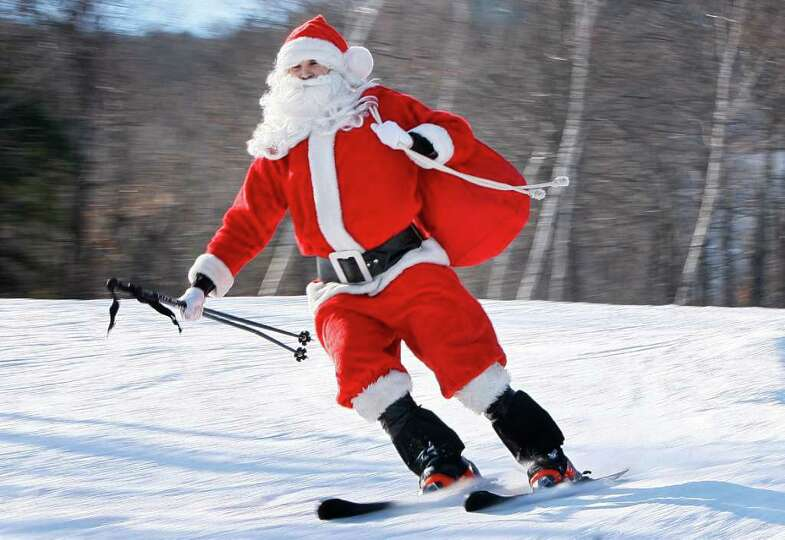 One of the 250 Santas participating in a fundraising event takes a run at Sunday River Ski Resort, S