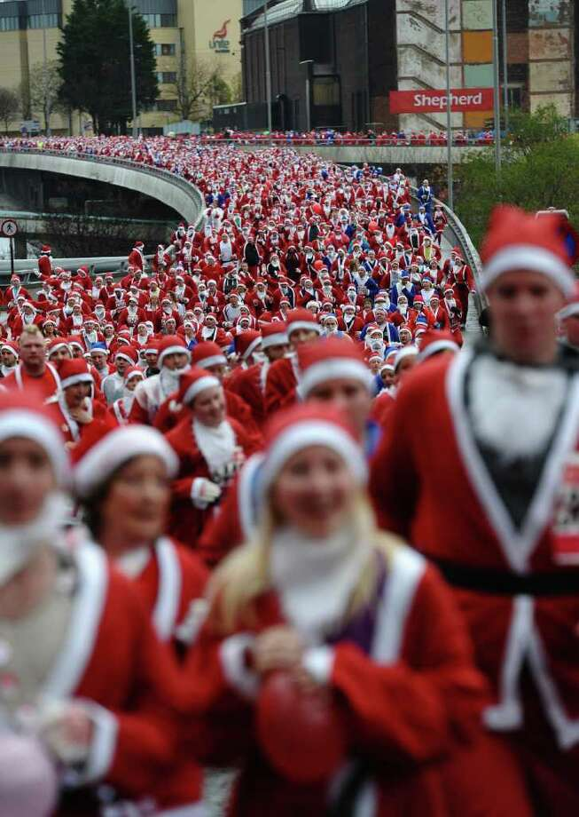 Competitors take part in the annual Santa Dash in Liverpool, north-west England on December 4, 2011. The five kilometer race sees thousands of entrants run through the streets of the city centre dressed as Santa Claus. Photo: PAUL ELLIS, Getty / AFP