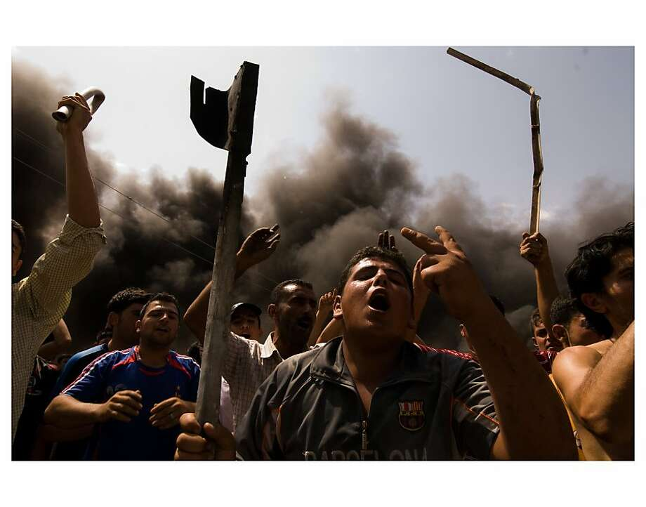 Daniel C. Britt's photo of a protest is part of a  collection offered by missing journalist Matthew Van Dyke's colleagues to raise awareness of his plight in Libya. Photo: Daniel C . Britt