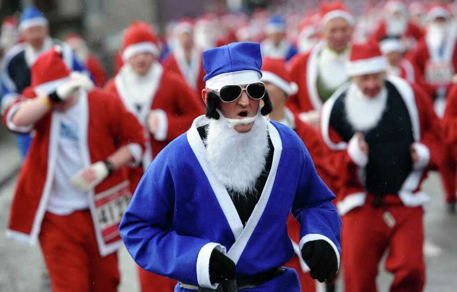 Competitors take part in the annual Santa Dash in Liverpool, north-west England on December 4, 2011. Photo: PAUL ELLIS, Getty / AFP