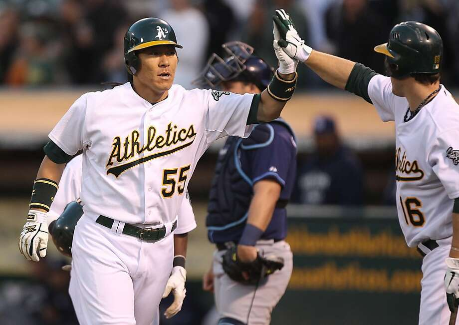 OAKLAND, CA - JULY 27:  Hideki Matsui #55 of the Oakland Athletics celebrates with Josh Willingham #16 after hitting a three run home run in the fourth inning against the Tampa Bay Rays at O.co Coliseum on July 27, 2011 in Oakland, California. Photo: Jed Jacobsohn, Getty Images