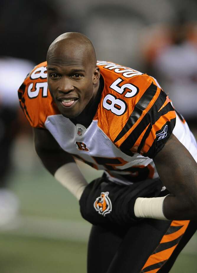 FILE - In this Jan. 3, 2010, file photo, Cincinnati Bengals wide receiver Chad Ochocinco warms up before an NFL football game against the New York Jets at Giants Stadium in East Rutherford, N.J. A person familiar with the deal says the New England Patriots have obtained Ochocinco from the Bengals. The person, who spoke Thursday, July 28, 2011, on condition of anonymity because neither team had announced the trade, says Ochocinco has agreed to a new three-year deal with New England. Photo: Bill Kostroun, AP