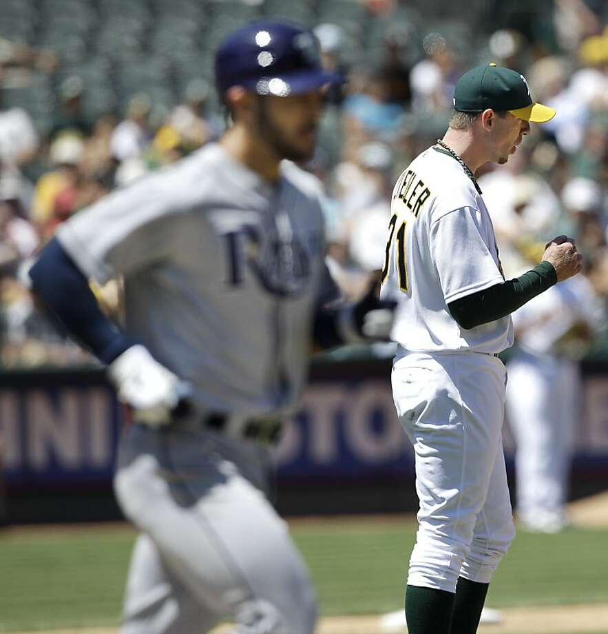 Oakland Athletics pitcher Brad Ziegler, right, reacts after walking Tampa Bay Rays' Sean Rodriguez, left, with the bases loaded to score Casey Kotchman in the seventh inning of a baseball game in Oakland, Calif., Thursday, July 28, 2011. Photo: Jeff Chiu, AP