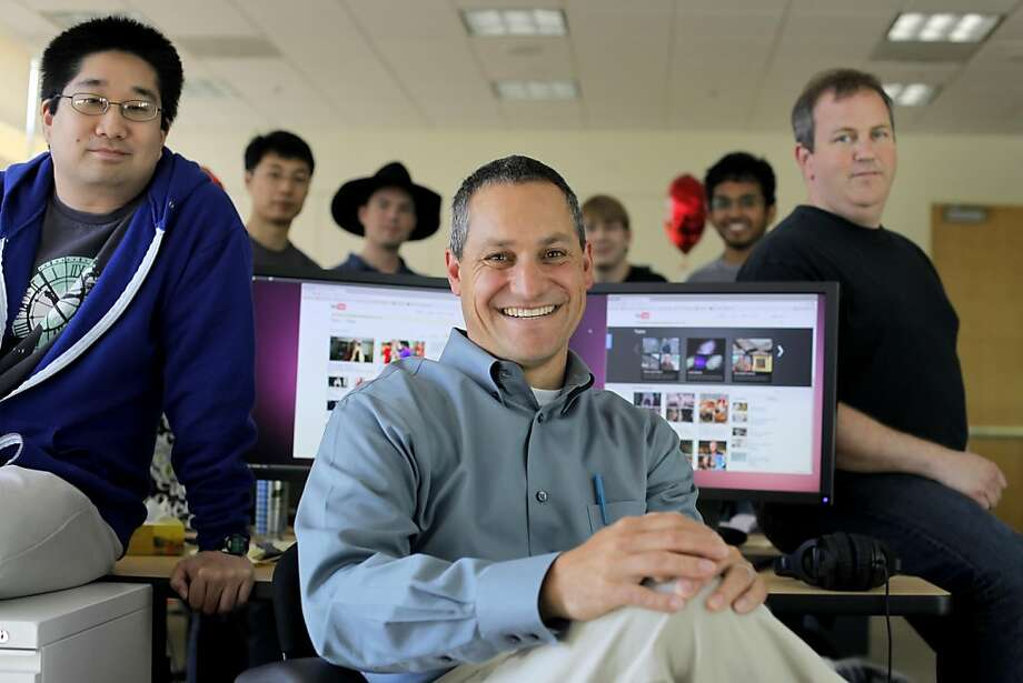 Christos Goodrow, center, head of engineering for YouTube's search and discovery team, Michael Ogawa, left, Yintao Liu, John Kraemer, Mike Yurko, Dasavathi Sampath, Bill Saphir, sit at their office,  Tuesday July 27, 2011, in San Bruno, Calif. Photo: Lacy Atkins, The Chronicle