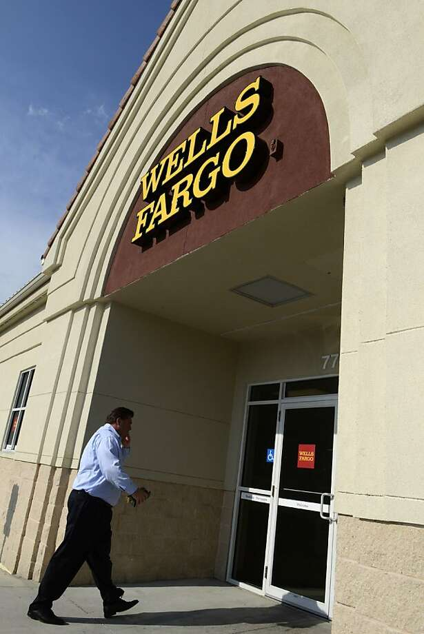 A customer walks up to a Wells Fargo & Co. bank branch in Orlando, Florida, U.S., on Monday, June 13, 2011. Jamie Dimon, chief executive officer of JPMorgan Chase & Co., announced plans to open as many as 2,000 branches, more than half of them in Florida and California, targeting states dominated by Bank of America Corp., the biggest U.S. bank by deposits, and Wells Fargo & Co., which has the largest branch network. Photographer: Phelan M. Ebenhack/Bloomberg  Ran on: 07-06-2011 Wells Fargo of San Francisco has chosen Kevin McQuilkin to oversee mergers and acquisitions for industrial companies.  Ran on: 07-28-2011 Last week, Wells Fargo was fined $85 million over claims that it steered buyers into subprime loans. Photo: Phelan M. Ebenhack, Bloomberg