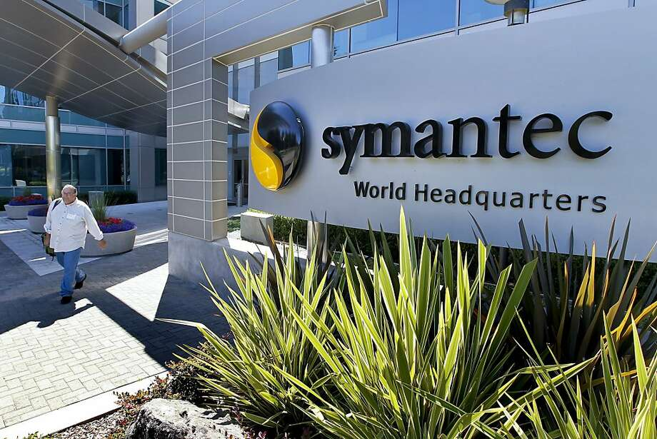 A visitor exits the headquarters building of Symantec Corp. in Mountain View, California, U.S., on Tuesday, Aug. 24, 2010. Intel Corp.' $7.68 billion purchase of McAfee Inc. may put pressure on rival Symantec Corp., the largest supplier of security software, to build hacker-thwarting technology inside corporate computers and forge new alliances to stay competitive. Sales will reach $16.5 billion this year in the global security software market according to Gartner Inc. Photographer: Tony Avelar/Bloomberg Photo: Tony Avelar, Bloomberg News