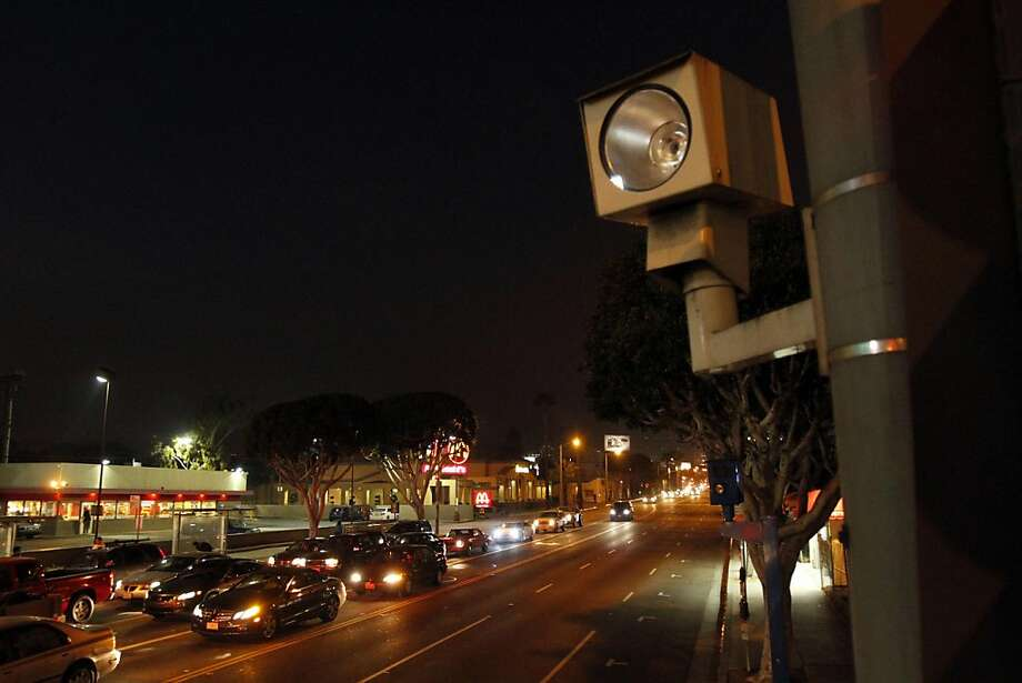In this January 19, 2011 file photograph, a red light camera is located at La Brea Ave. and Santa Monica Blvd. in Los Angeles, California. The Los Angeles City Council voted unanimously Wednesday, July 27, 2011, to halt the city's controversial red-light camera program, which has ticketed more than 180,000 motorists since beginning in 2004. The program will officially end July 31. (Glenn Koenig/Los Angeles Times/MCT) Photo: Glenn Koenig, MCT