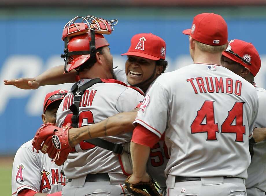 Los Angeles Angels starting pitcher Ervin Santana, center, gets a hug from catcher Bobby Wilson after throwing a no-hitter in a 3-1 win over the Cleveland Indians in a baseball game Wednesday, July 27, 2011, in Cleveland. First baseman Mark Trumbo (44) joins in at right. Photo: Mark Duncan, AP