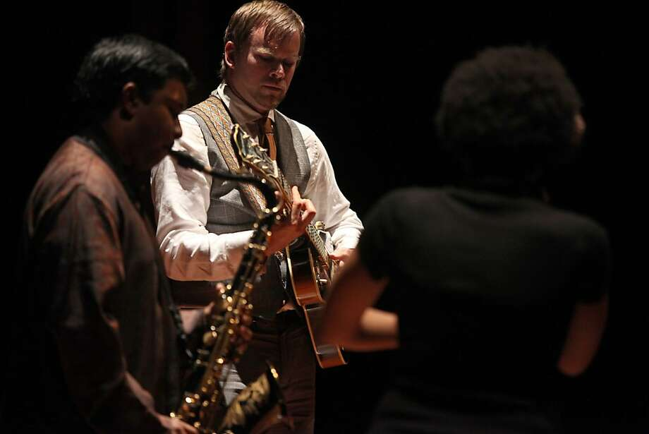 Vocalist Meklit Hadero (back facing), saxophonist Prasant Radhakrishnan (left), and multidisciplinary artist Todd T. Brown (middle) performing at the Koret Auditorium in San Francisco, Calif., on Friday,  July 8, 2011. They call the group Nefasha Ayer. Photo: Liz Hafalia, The Chronicle
