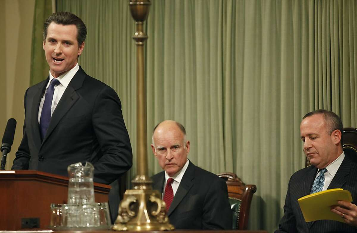 Lt. Gov. Gavin Newsom, left, introduces Gov. Jerry Brown, center, before Brown's State of the State address during a joint session of the California legislature at the Capitol in Sacramento, Calif., on Monday, Jan. 31, 2011. At the right is Senate President Pro Tem Darrell Steinberg.