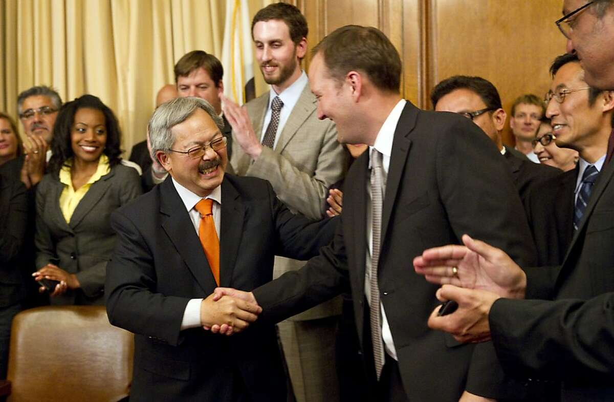 San Francisco Mayor Ed Lee shakes the hand of Greg Wagner, the Mayor's Budget Director, after signing the budget for the 2011 to 2012 fiscal year during a ceremony at City Hall in San Francisco, Calif., on Tuesday, July 26, 2011.