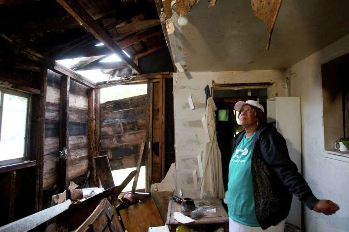 Sharon Thomas, 56, stands in what was once the kitchen of her Hurricane-Ike damaged home Monday, Dec. 5, 2011, in Houston. Thomas is concerned that the City of Houston will not allocate enough money to repair homes like hers. ( Brett Coomer / Houston Chronicle )