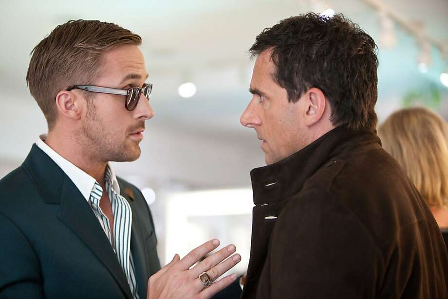 "Ryan Goslin, left, as Jacob and Steve Carell as Cal in Warner Bros. Pictures' comedy, ""Crazy, Stupid, Love,"" a Warner Bros. Pictures release. (Ben Glass/Courtesy of Warner Bros. Pictures/MCT) Photo: Handout, MCT"