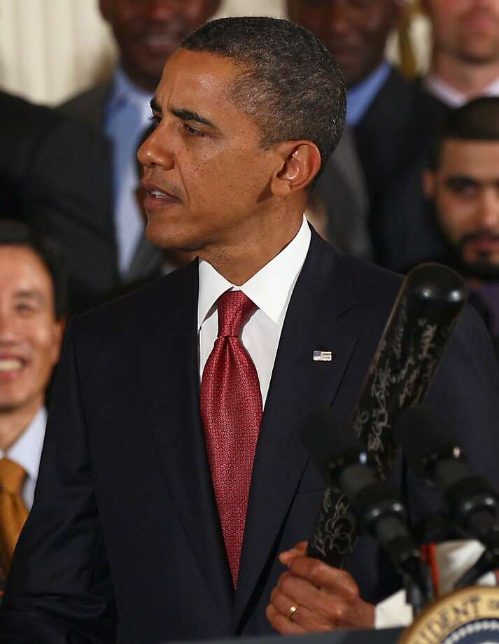 WASHINGTON, DC - JULY 25:  U.S. President Barack Obama speaks while holding a baseball bat given to him as a gift during an event with the World Series champions San Francisco Giants in the East Room of the White House July 25, 2011 in Washington, DC. TheGiants defeated the Texas Rangers in the 2010 World Series, giving the franchise their first World Series championship since 1954, and the first since relocating to San Francisco in 1958. Photo: Win McNamee, Getty Images