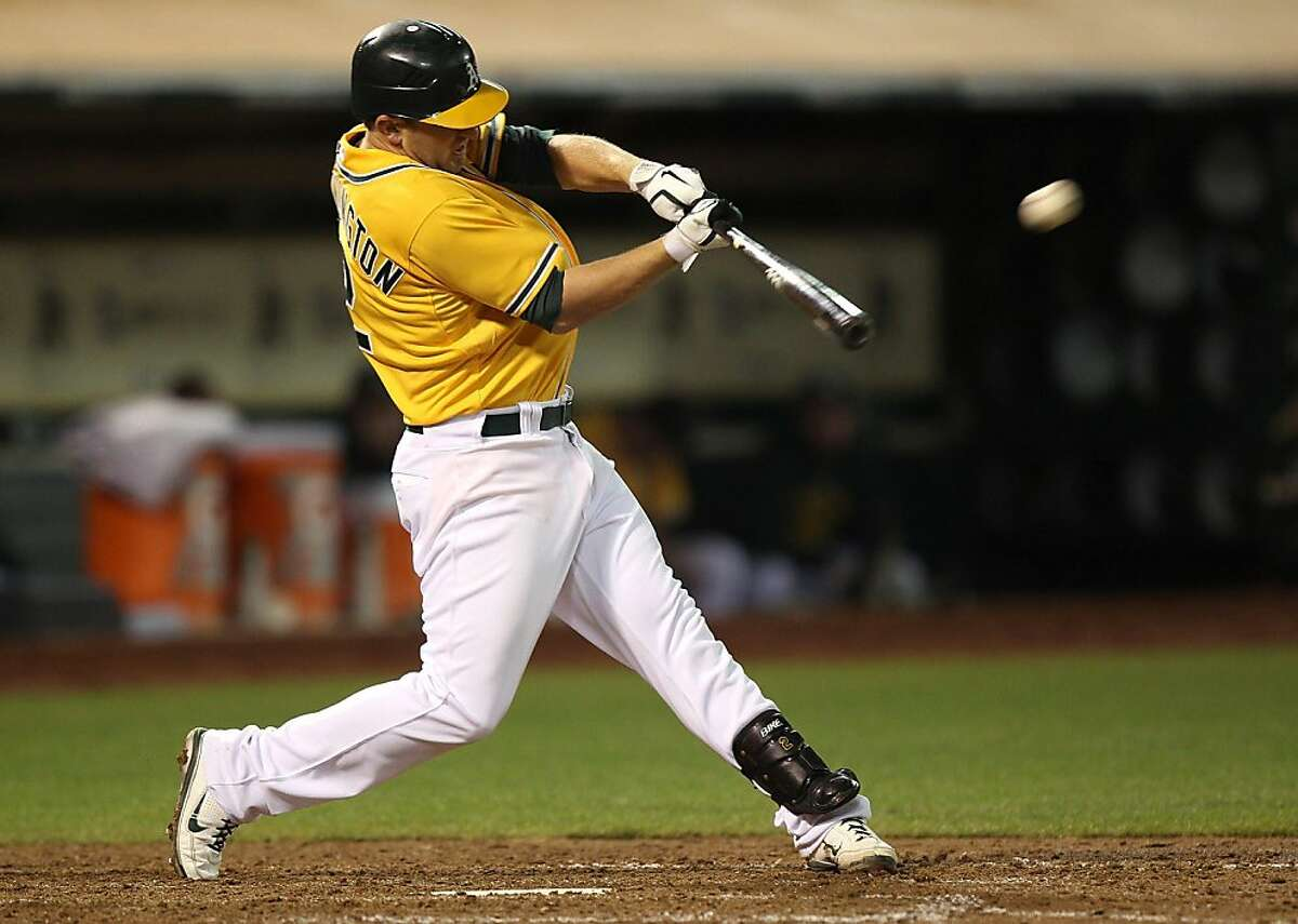 OAKLAND, CA - JULY 26: Cliff Pennington #2 of the Oakland Athletics hits an RBI double in the sixth inning against the Tampa Bay Rays at O.co Coliseum on July 26, 2011 in Oakland, California.