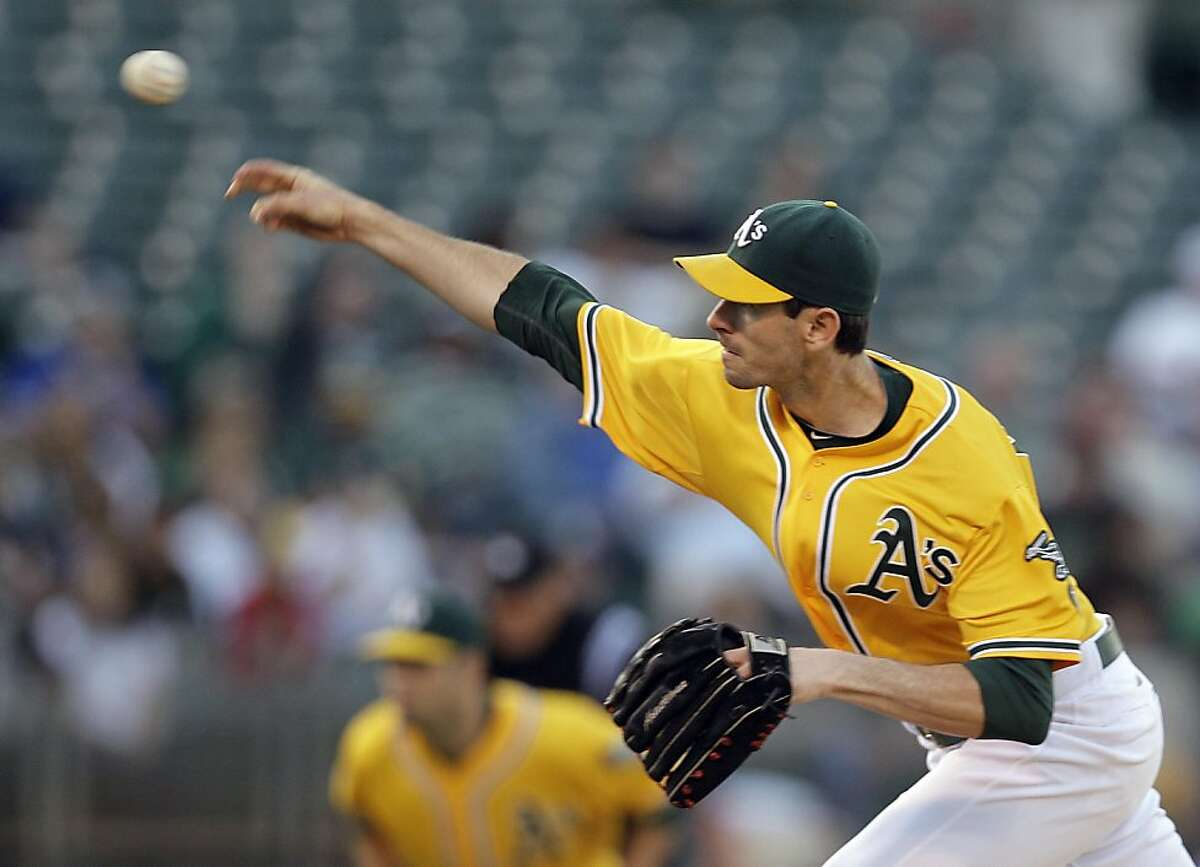 Oakland Athletics pitcher Brandon McCarthy works against the Tampa Bay Rays during the first inning of a baseball game Tuesday, July 26, 2011, in Oakland, Calif.