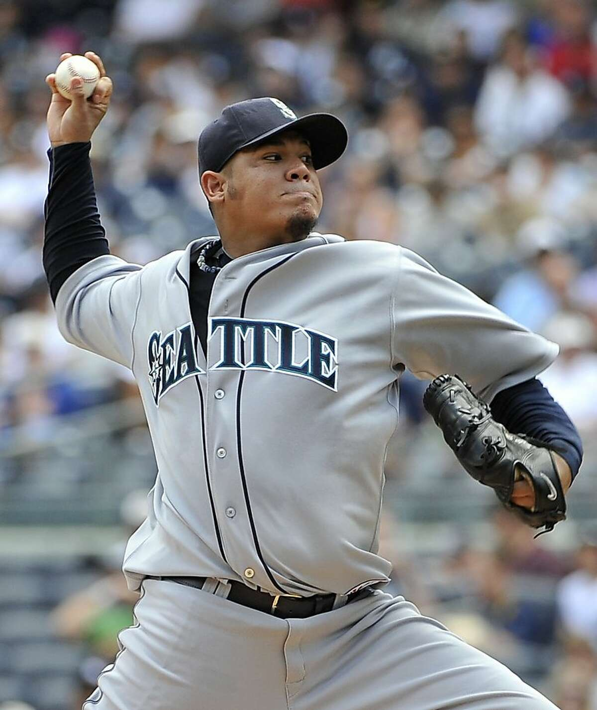 Seattle Mariners starting pitcher Felix Hernandez throws against the New York Yankees in the first inning of a baseball game Wednesday, July 27, 2011 at Yankee Stadium in New York. The Mariners won 9-2.