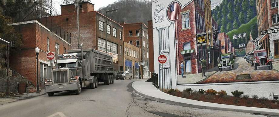 In this Feb. 9, 2011 file photo, a coal truck drives out of downtown Welch, W.Va. Rural places account for just 16 percent of the nation's population, the lowest share ever, while metro areas are booming into sprawling megalopolises. Photo: Jon. C. Hancock, AP