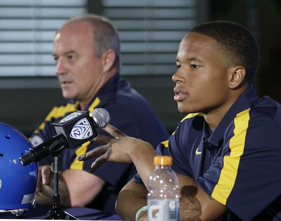 California head coach Jeff Tedford, left, and wide receiver Marvin Jones talk to reporters at the Pac-12 football media day in Los Angeles Tuesday, July 26, 2011. Photo: Reed Saxon, AP