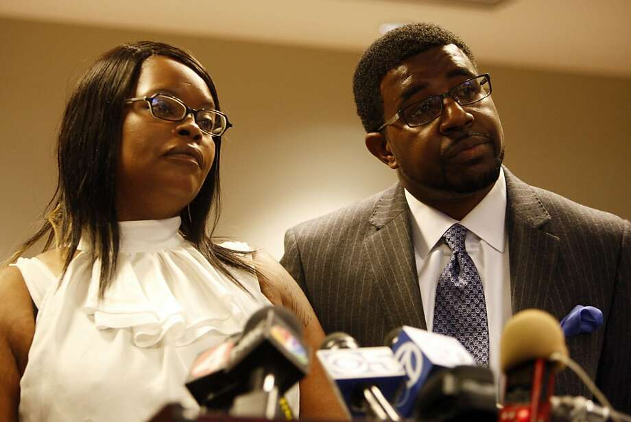 Denika Chatman, Kenneth Harding's mother, and Adante Pointer answer questions during the press conference on July 25, 2011. The family of Kenneth Harding -- the man shot to death in the Bay View last week, allegedly by himself after he shot at police -- held a press conference in the offices of attorney John Burris, whom they have retained to presumably file a lawsuit. Photo: Maddie McGarvey, The Chronicle