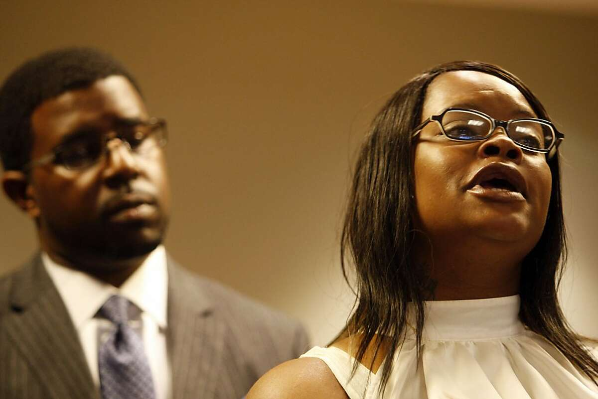Denika Chatman, Kenneth Harding's mother, and Adante Pointer answer questions during the press conference on July 25, 2011. The family of Kenneth Harding -- the man shot to death in the Bay View last week, allegedly by himself after he shot at police -- held a press conference in the offices of attorney John Burris, whom they have retained to presumably file a lawsuit.