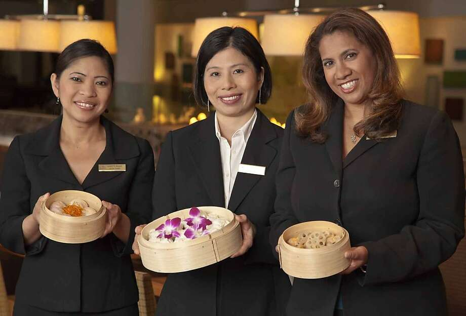 Hilton Huanying (Hilton San Francisco Financial District) Hilton San Francisco Financial District Team Members prepare for the launch of Hilton Huanying, a tailored experience for Chinese travelers. Thirty hotels are already enrolled in the program, whichdebuts on August 16 in San Francisco. (From left to right: Nannette Morris, Catering Sales and Convention Services Manager; Michelle Kong, Housekeeper; Rachel Prasad, Senior Convention Services Manager, Hilton San Francisco Financial District). Photo: Hilton Hotels And Resorts