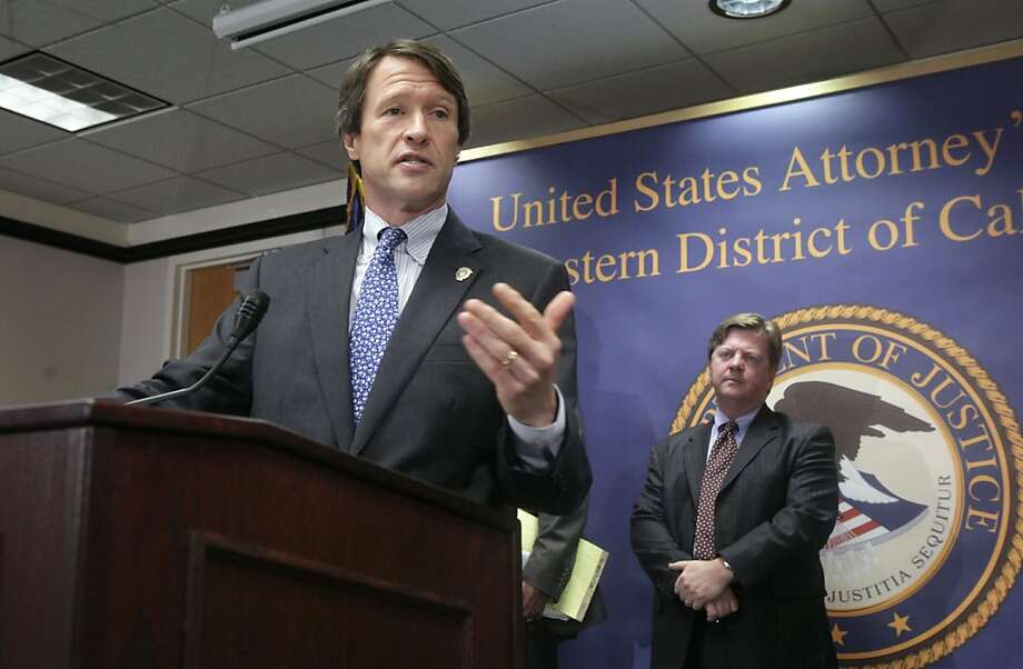 Benjamin Wagner, the U.S. attorney for the Eastern District of California, discusses the indictment of 14 people who were charged with participating in sham marriages to help others gain U.S. citizenship and evade immigration laws, at  a news conference in Sacramento, Calif., Tuesday, July 26, 2011.  Prosecutors have charged Sergey Potepalov, 55, of Citrus Heights, and 13 other defendants with conspiracies to commit marriage fraud, to defraud the United States, to make false statement and to induce an alien to enter and remain in the United States.  At right is Dan Lane, assistant special agent in charge from Homeland Security Investigations. Photo: Rich Pedroncelli, AP