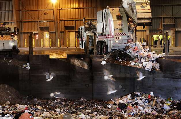 Seagulls scavenge for food as trash collectors dump material at the Recology Transfer Station 501, Tuesday July 26, 2011, in San Francisco, Calif. The San Francisco Board of Supervisors are expected to approve a controversial contract to send tons of San Francisco trash by way of train to Yuba City. Photo: Lacy Atkins, The Chronicle