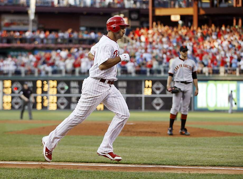 Philadelphia Phillies' Raul Ibanez, left, rounds the bases after hitting a three-run home run off San Francisco Giants starting pitcher Barry Zito in the first inning of a baseball game, Tuesday, July 26, 2011, in Philadelphia. Photo: Matt Slocum, AP