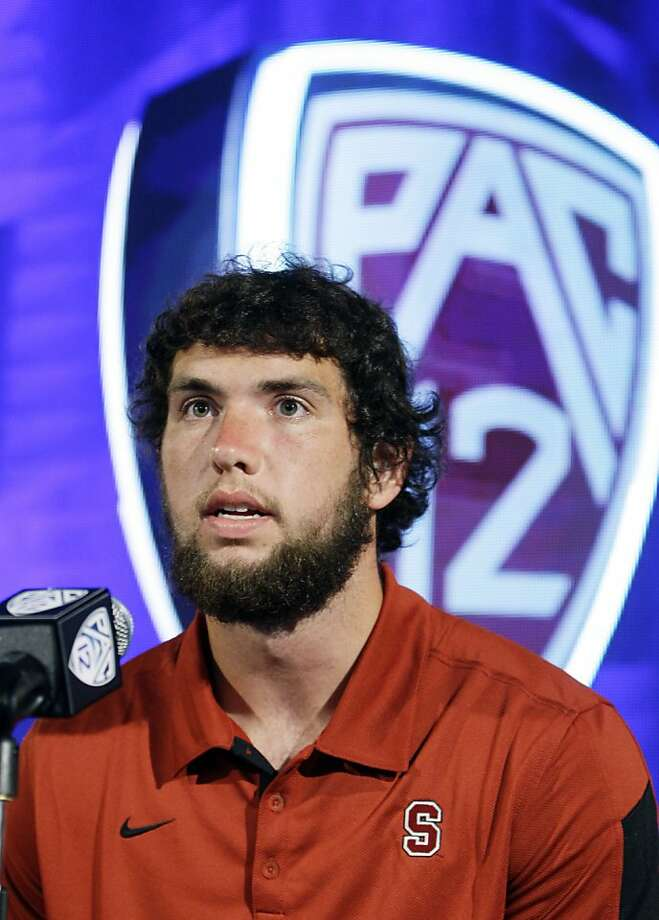 Stanford quarterback Andrew Luck talks to reporters at the Pac-12 football media day in Los Angeles on Tuesday, July 26, 2011. Photo: Reed Saxon, AP
