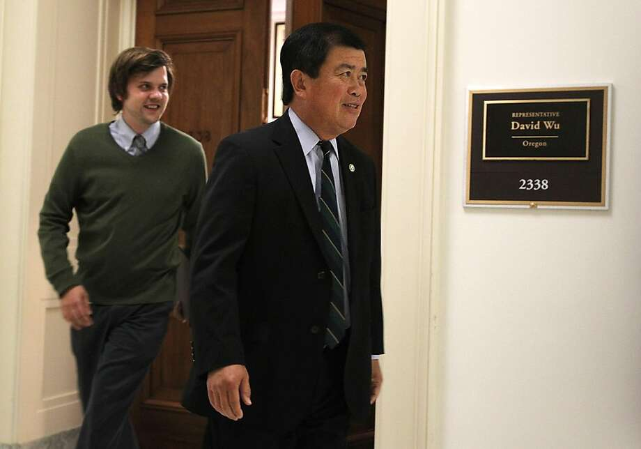 """WASHINGTON - JULY 26:  U.S. Rep. David Wu (D-WA) (R), followed by his communications director Erik Dorey (L), leaves his office for a vote on the House floor July 26, 2011 on Capitol Hill in Washington, DC. Wu announced earlier in the day that he will resign from his position after accusations of an """"unwanted sexual encounter"""" from the 18-year-old daughter of a donor. Photo: Alex Wong, Getty Images"""