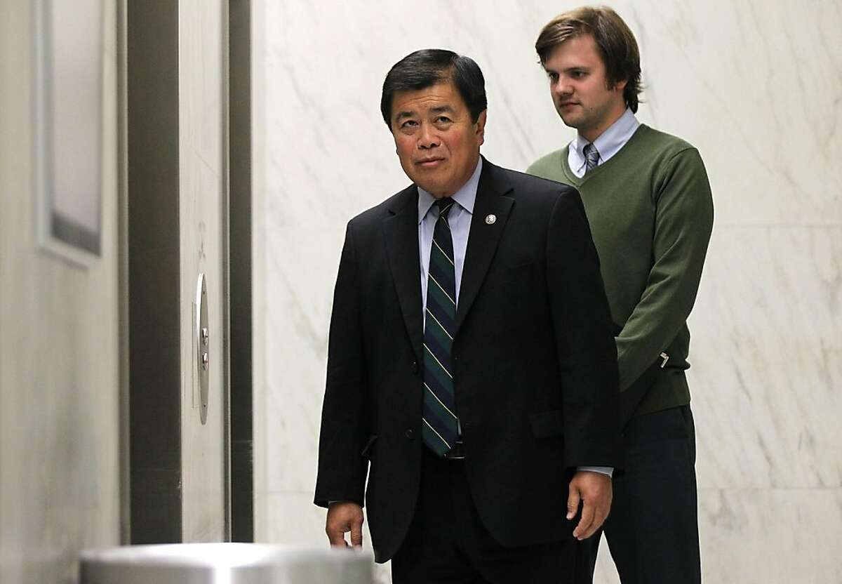 U.S. Rep. David Wu (D-WA) (L) and his communications director Erik Dorey (R) wait for an elevator while he is on his way for a vote on the House floor July 26, 2011 on Capitol Hill in Washington, DC. Wu announced earlier in the day that he will resign from his position after accusations of an
