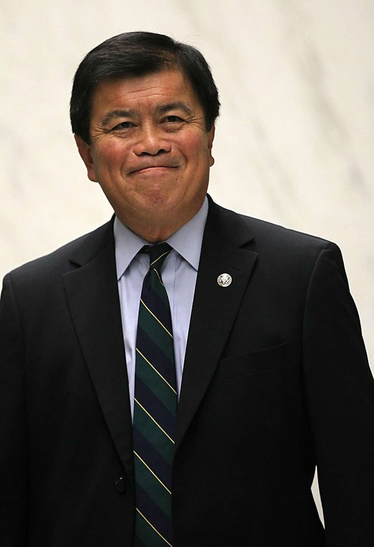 U.S. Rep. David Wu (D-WA) waits for an elevator while he is on his way for a vote on the House floor July 26, 2011 on Capitol Hill in Washington, DC. Wu announced earlier in the day that he will resign from his position after accusations of an