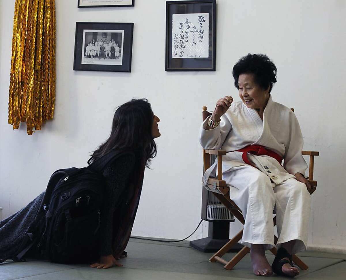 A student greets Sensei Keiko Fukuda prior to the class starting. At 98 years old Fukuda still teaches Judo three days a week at the women's dojo in San Francisco's Noe Valley. Thursday July 21, 2011.
