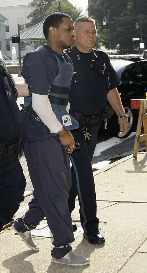 Abdulhakim Muhammad, left, is escorted to the Pulaski County Courthouse in Little Rock, Ark., Monday, July 25, 2011, for his trial in the 2009 shooting death of an Army recruiter and wounding of another soldier. Photo: Danny Johnston, AP