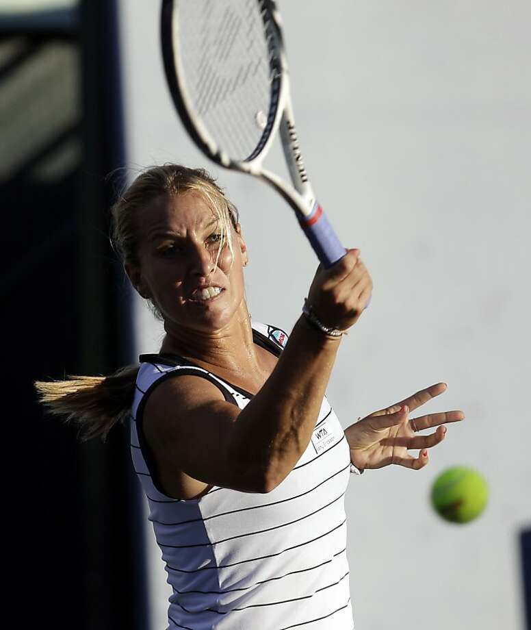 Dominika Cibulkova, of Slovakia, returns to Kimiko Date Krumm, of Japan, during the Bank of the West tennis tournament in Stanford, Calif., Monday, July 25, 2011. Photo: Marcio Jose Sanchez, AP
