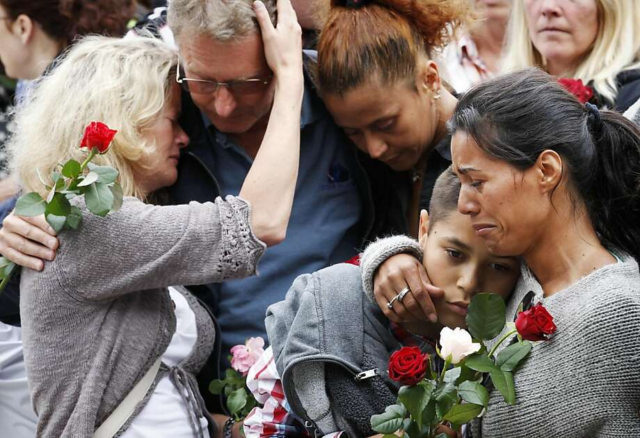 "People comfort each other outside Oslo City Hall as they participate in a ""rose march"" in memory of the victims of Friday's bomb attack and shooting massacre Monday July 25, 2011. Anders Behring Breivik has admitted bombing Norway's capital and opening fire on a political youth group retreat, but he entered a plea of not guilty, saying he wanted to save Europe from Muslim immigration. Police announced Monday that they had dramatically overcounted the number of people slain in a shooting spree at a political youth group's island retreat and were lowering the confirmed death toll from 86 to 68. (AP Photo/Erlend Aas, Scanpix Norway) NORWAY OUT Photo: Aas, Erlend, AP"