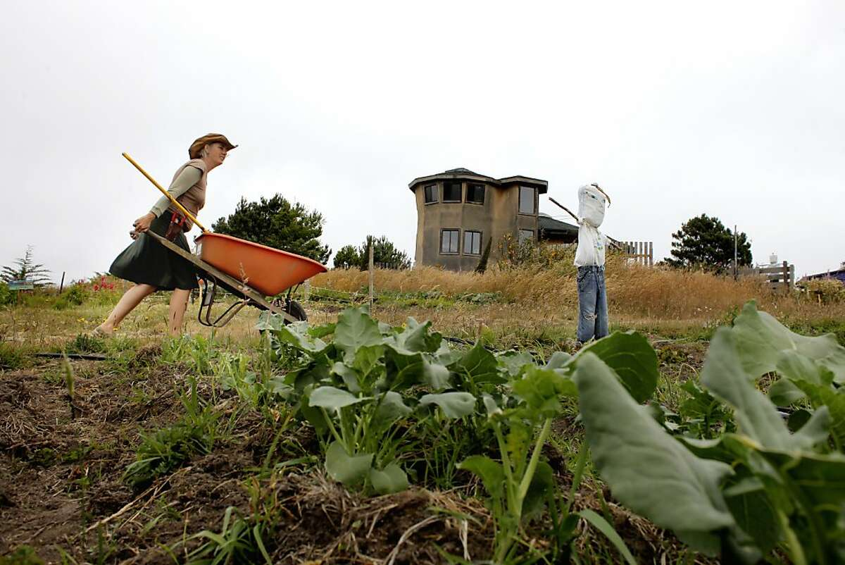 Jennifer Ketring hauls compose through the garden, Monday June 11, 2011, in Point Arena, Calif.